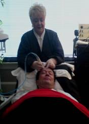 Karen using Professional Crystal Microdermabrasion on longtime KARAMAR Client - Dr. John H. - MD